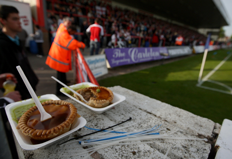 Pie at football match