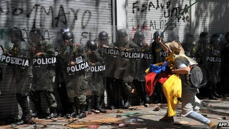 Protester confronts police in Bogota. 29 Aug 2013