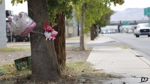 A makeshift memorial on a tree is shown in Phoenix 29 August 2013