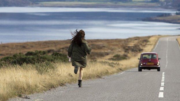 Girl running to car
