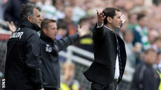 Dundee United manager Jackie McNamara watches his side in action against Celtic