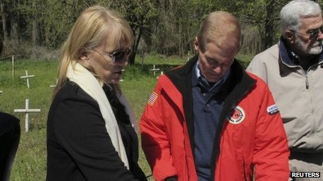 Forensic anthropologist shows a map of the graveyard to Senator Bill Nelson, during a tour of the closed Dozier School for Boys in Marianna, Florida.