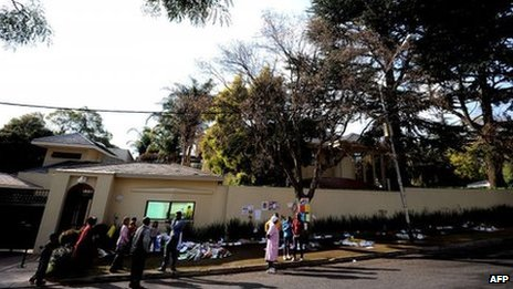 Well-wishers gather on July 8, 2013 outside the home of former South African President Nelson Mandela in Johannesburg.