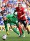 Craig Bellamy gets beyond Everton goalkeeper Tim Howard