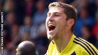 Ben Davies celebrates