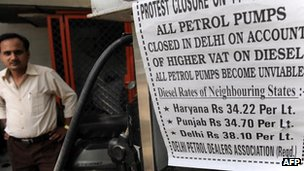 A protest sign outside a fuel pump in India