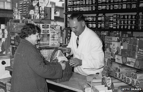 A customer buys products from a local grocer