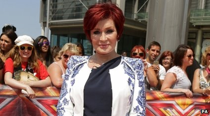 Sharon Osbourne on the red carpet surrounded by fans