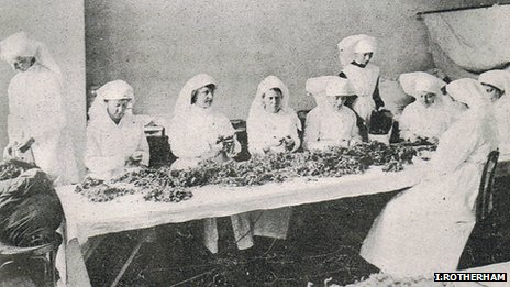 Women in North America sorting through collection of dried sphagnum moss (Image courtesy of Prof Ian Rotherham)
