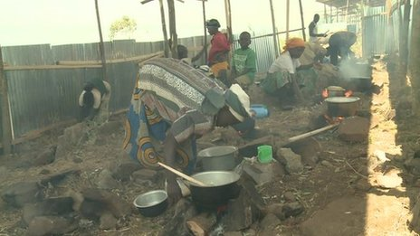 Women cooking at a camp in Rwanda