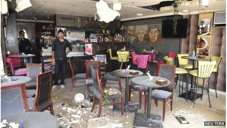 A cafe damaged by a rocket in the al-Maliki district of Damascus, Syria (2 Sept 2013)