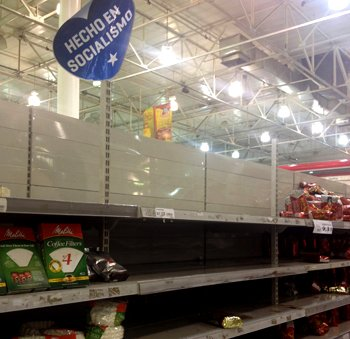 "Supermarket shelves and sign reading ""Made in socialism"""