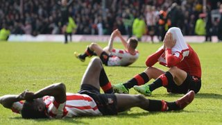 Brentford players after Marcello Trotta's penalty miss