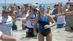 Diana Nyad emerges from the Atlantic Ocean after completing a 111 mile swim from Cuba to Key West, Florida