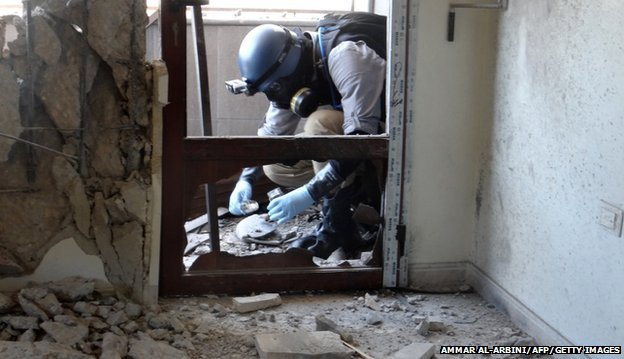 A UN inspector painstakingly gathers samples at the site of an alleged chemical attack. These will be analysed in labs across the world