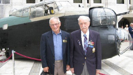 Ken with his son Keith in front of a Lancaster