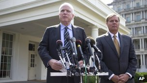 Senator John McCain accompanied by Senator Lindsey Graham speaks with reporters outside the White House in Washington 2 September 2013