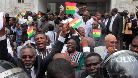 Supporters of Ghana's President John Mahama celebrate in Accra on 29 August 2013