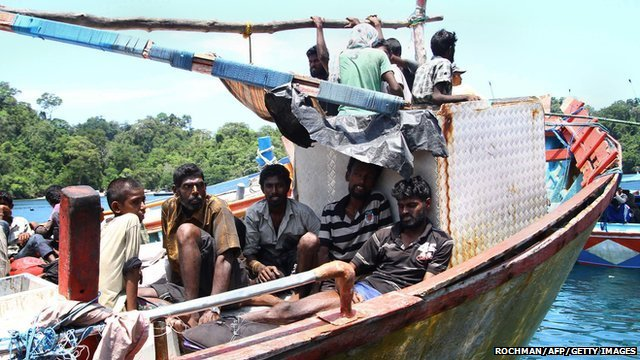 Sri Lankan asylum seekers in Indonesia rest after being rescued by local fishermen