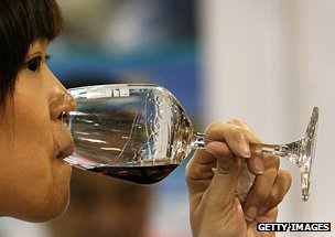 Chinese woman drinking wine