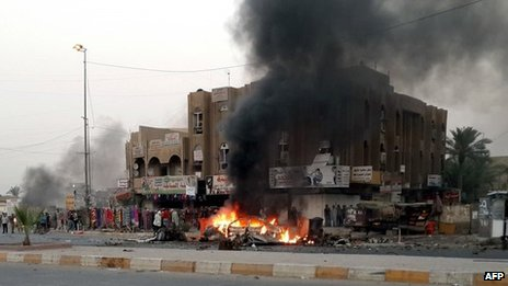 Flames rise from the site of a car bomb attack in Talibiya, Baghdad (3 September 2013)