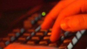 Man types on keyboard