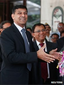 "Raghuram Rajan, newly appointed governor of Reserve Bank of India (RBI), gestures while posing for the photographers after his arrival at the bank""s headquarters in Mumbai September 4, 2013"