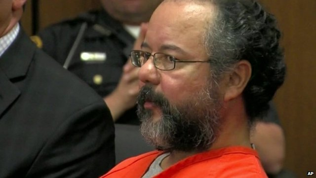 Ariel Castro in an orange jumpsuit inside court.