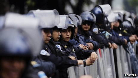 Riot police stand guard outside the Mexican Senate on 3 September 2013