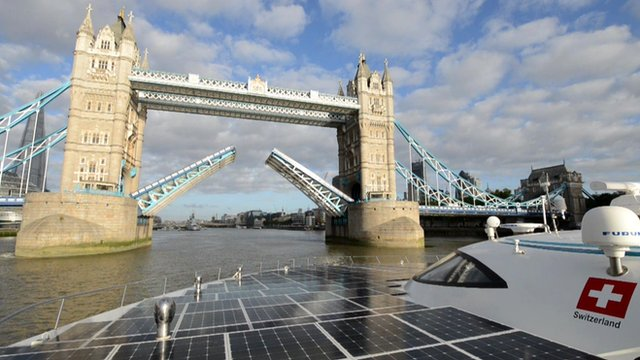 Solar-powered boat approaches Tower Bridge in London