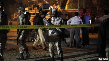 A Ranger stands guard at the site of a bomb explosion in Karachi April 3, 2013.