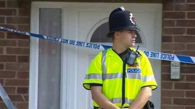 Police officer outside flat in Colchester
