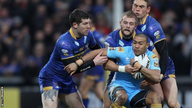 Kevin Penny is surrounded by three Leeds players