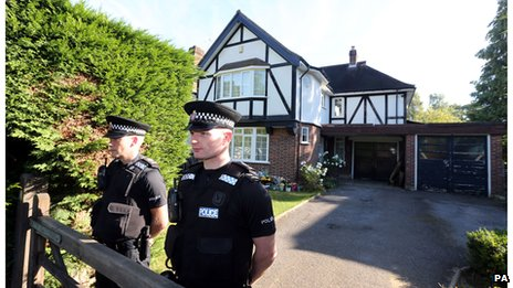 Police outside the home of Saad al-Hilli in Claygate, Surrey