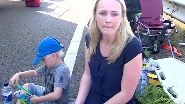 Woman on roadside with son