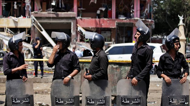 Security guards at scene of bomb attack in Nasr City, Cairo, on 5 September 2013