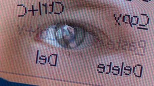 Child's eye reflected on screen