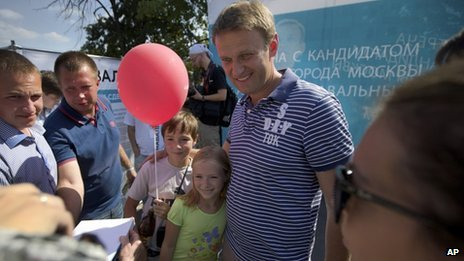 Alexei Navalny, centre, poses for a photo in downtown Moscow on 21 August