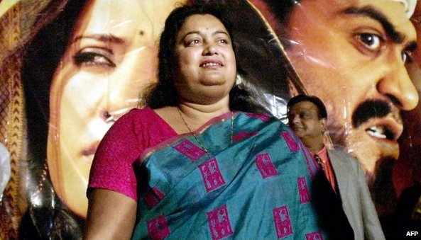 "In this photograph taken on December 17, 2002, Indian author Sushmita Banerjee poses at a press conference announcing the launch of the movie ""Escape From Taliban"" in Mumbai"