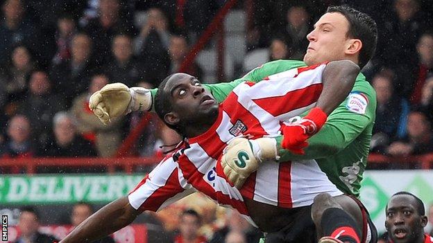 Clayton Donaldson and Portsmouth keeper Simon Eastwood