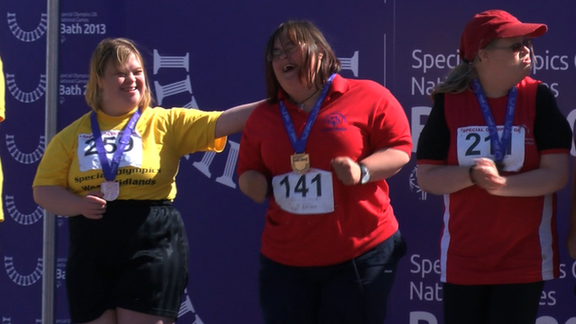 Special Olympics competitors celebrate gold medal