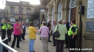 Members of public and police outside Keighley Town Hall