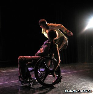 man standing and woman in wheelchair in dance performance