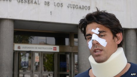 Thomas Drouet leaves a court house bandaged and wearing a neck brace in Madrid on 6 May 2013.