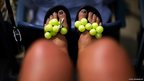 Flip-flops decorated with tennis balls
