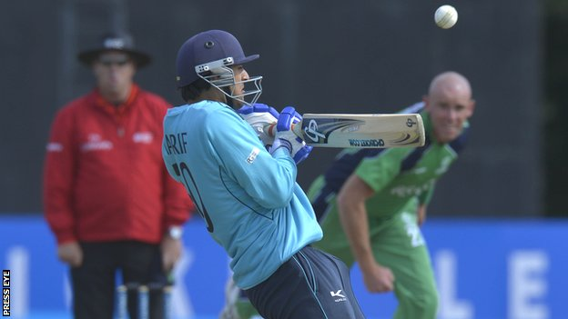 Scotland's Safyaan Sharif plays a shot with Trent Johnston bowling