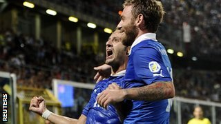 Alberto Gilardino (L) celebrates with his team mate Daniele De Rossi after scoring for Italy