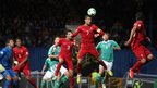 Cristiano Ronaldo clears the ball for Portugal before going on to score a second-half hat-trick at Windsor Park
