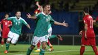 Jamie Ward celebrates after scoring Northern Ireland's second goal in the Group F qualifier