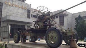 A military vehicle sits outside a museum in Dandong, China